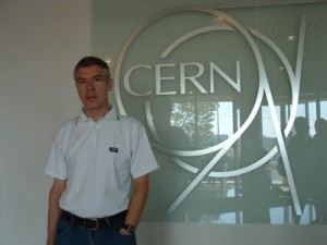 Photo of Jim McGovern standing beside CERN logo